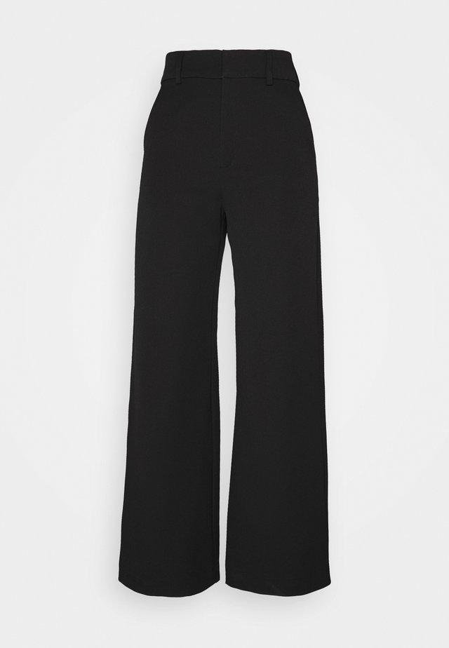 GENNIE - Trousers - black