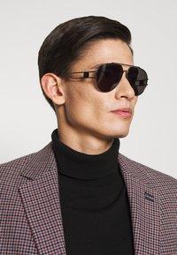MCM - Sluneční brýle - grey - 1