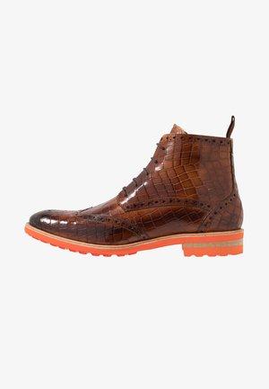EDDY  - Šněrovací kotníkové boty - cognac