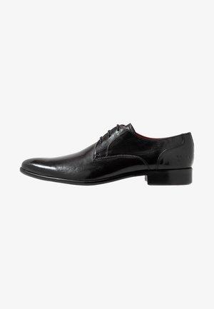 TONI - Zapatos con cordones - black