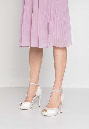 Peeptoe heels - white