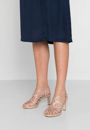 High heeled sandals - stone
