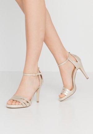 Korolliset sandaalit - gold