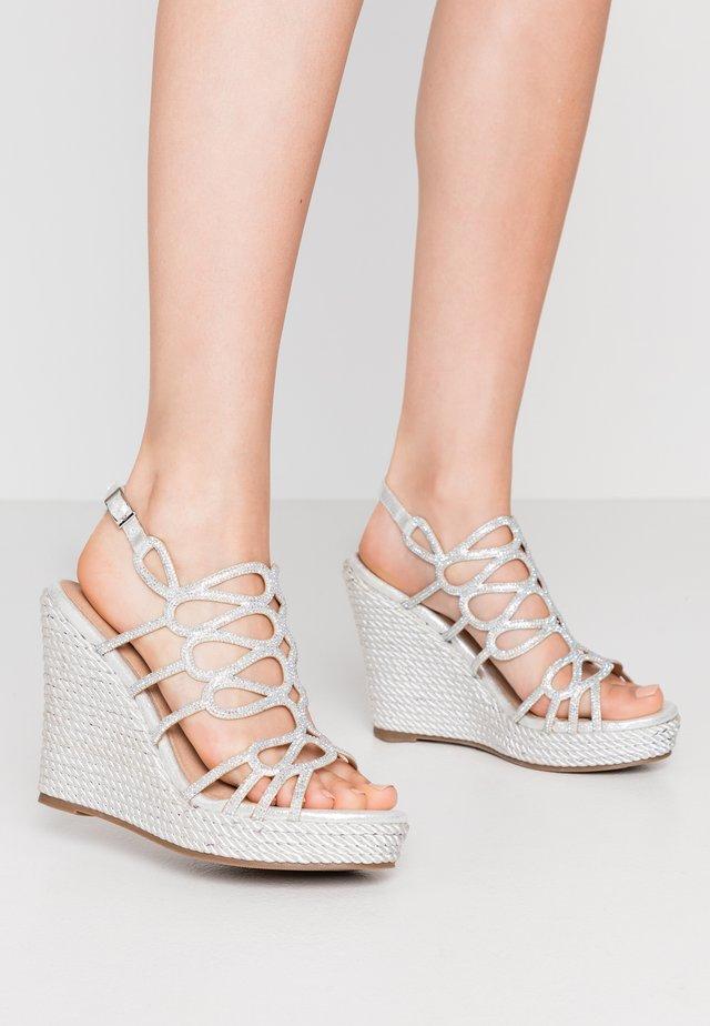 High heeled sandals - silver