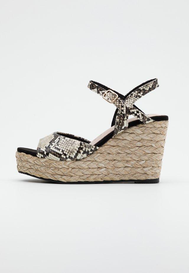 High heeled sandals - black/white
