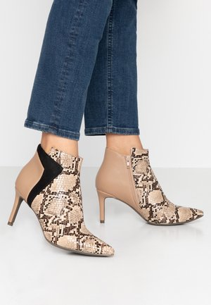 High heeled ankle boots - sand