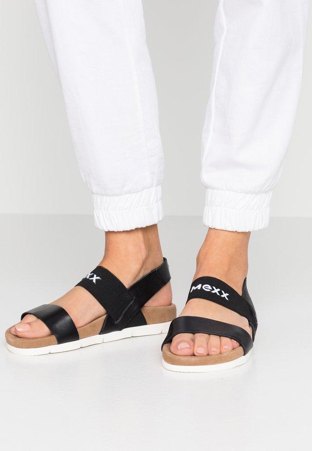 CHAELA - Sandaalit nilkkaremmillä - black