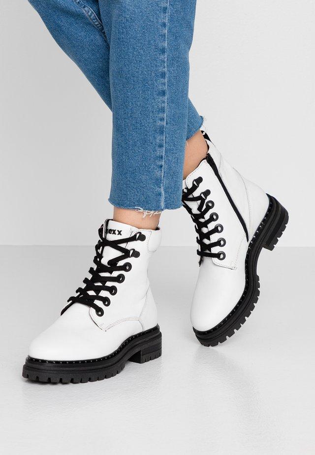 DEVI - Platform ankle boots - white
