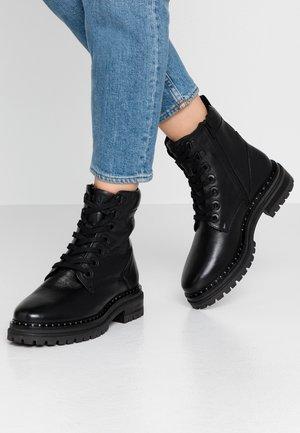 DEVI - Kotníkové boty na platformě - black