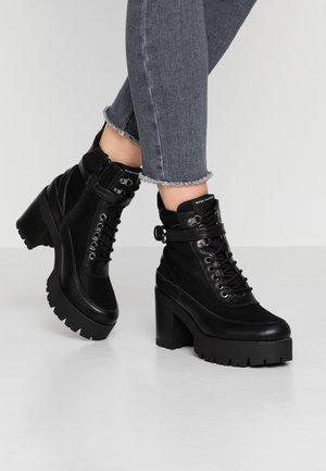DELINE - Platform ankle boots - black