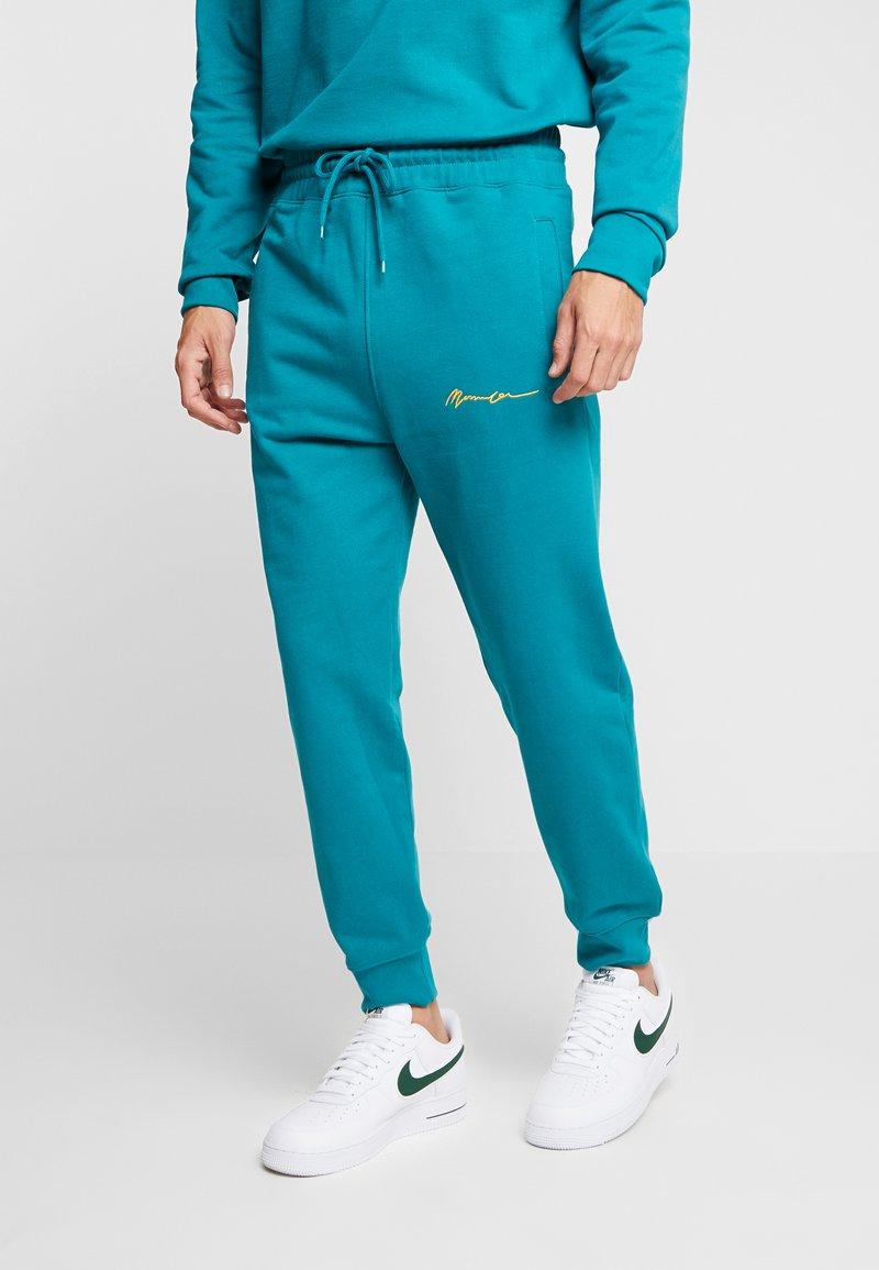 Mennace - 90S SIGNATURE - Tracksuit bottoms - turquoise