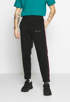 CONTRAST PIPING JOGGER - Tracksuit bottoms - black