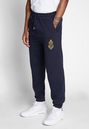 COLLEGIATE PRINT JOGGERS - Pantalon de survêtement - navy