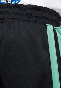 Mennace - SIDE STRIPE TRICOT  - Träningsbyxor - black/green - 3