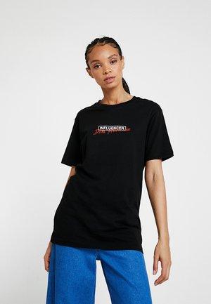 LADIES DONT FOLLOW ME TEE - T-shirt imprimé - black