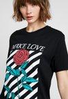 Merchcode - LADIES MAKE LOVE TEE - T-shirts print - black