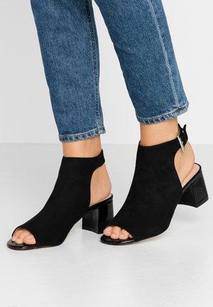 SHIMMER BUCKLE - Sandals - black