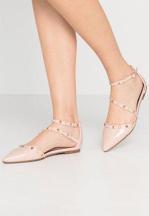 LEXA ASYMETRIC STUD - Ankle strap ballet pumps - nude