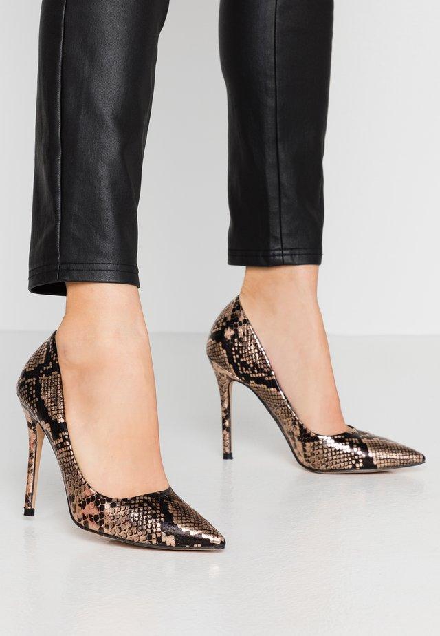 CHAOS SEXY COURT - High heels - bronze