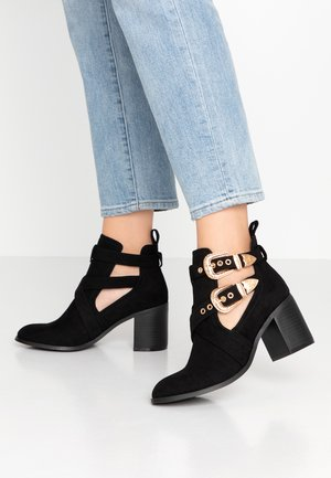 CUT OUT - Ankle boot - black
