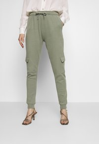 Miss Selfridge - CARGO - Tracksuit bottoms - khaki - 0