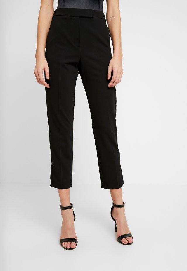 TUX SIDE - Trousers - black