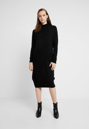 POCKET MIDI DRESS - Gebreide jurk - black