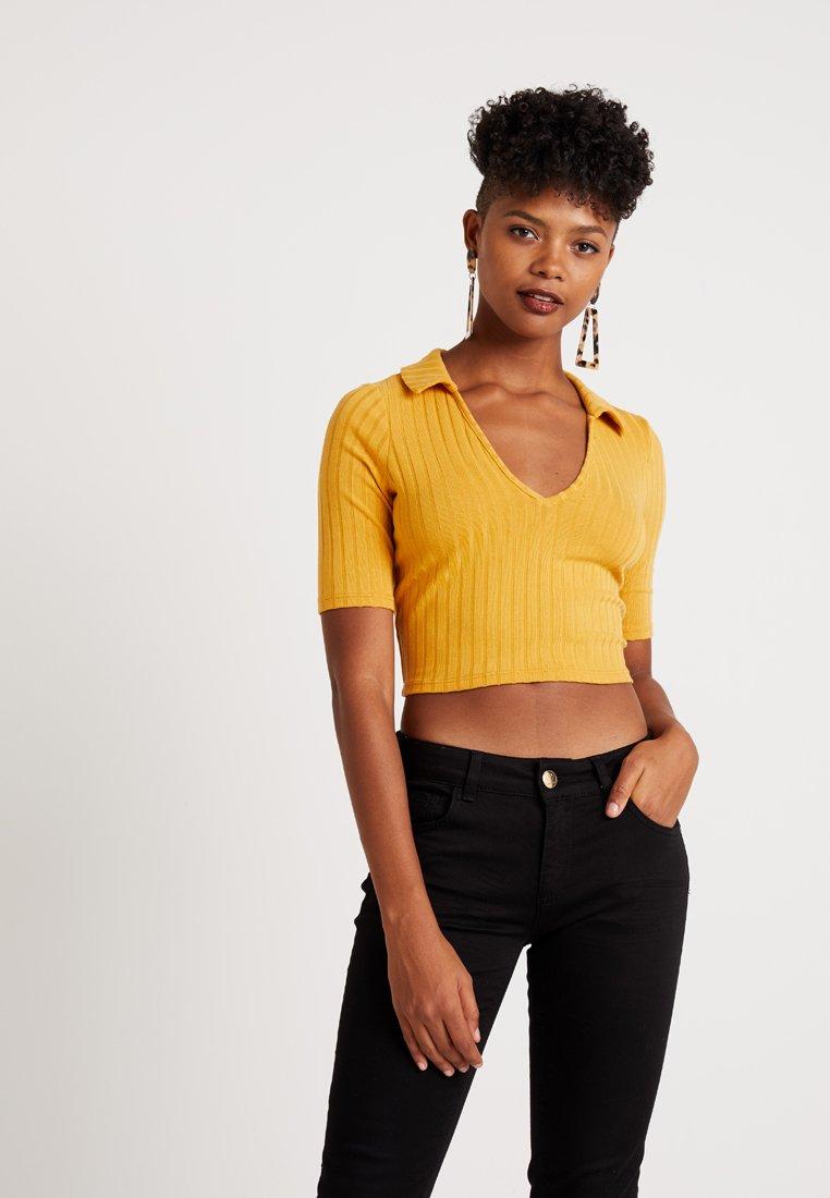Miss Selfridge - V NECK TEE - T-Shirt print - mustard