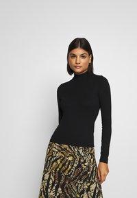 Miss Selfridge - TURTLE NECK - Long sleeved top - black - 0
