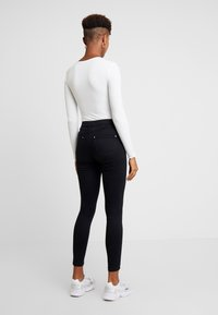 Miss Selfridge - LIZZIE - Jeans Skinny Fit - black - 2