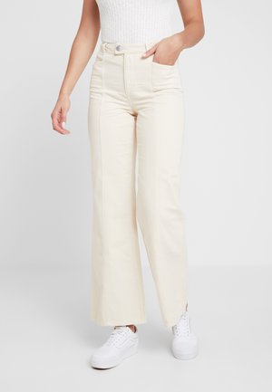 FRONT SEAM - Flared Jeans - white