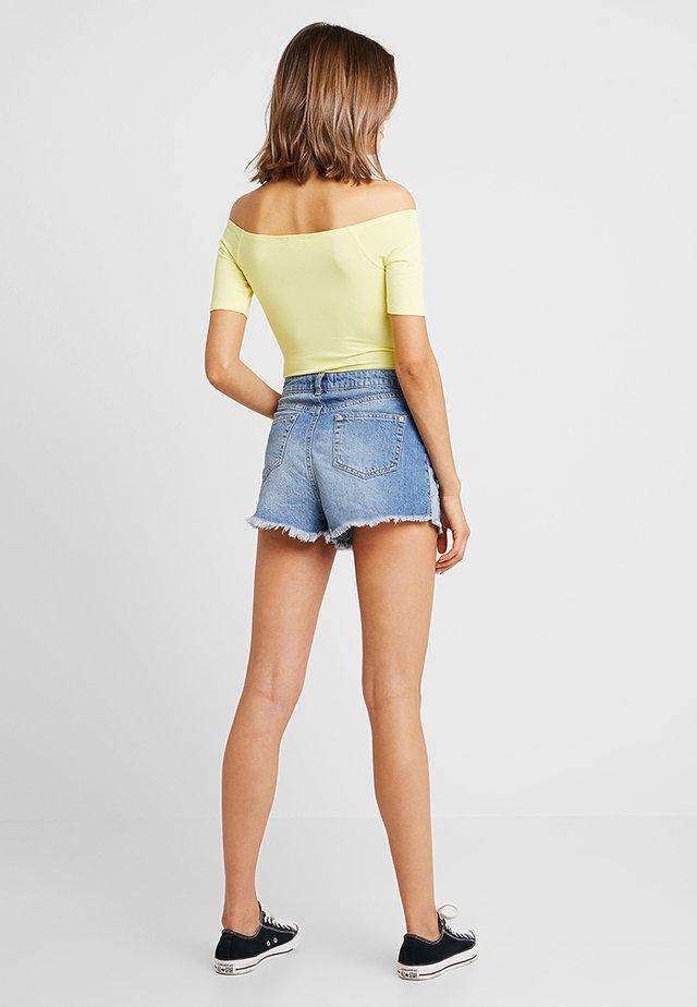 SIDE PANEL - Denim shorts - blue denim