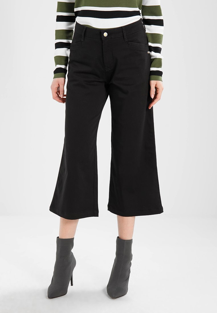 Monkee Genes - CROPPED ALL PARALLEL - Trousers - black