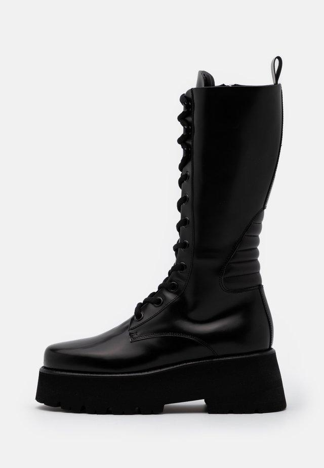 SCARPA DONNA - Stivali con plateau - black