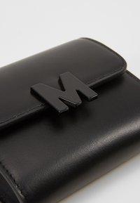 MSGM - BORSA DONNA BRAND MINI BAG - Across body bag - black - 2