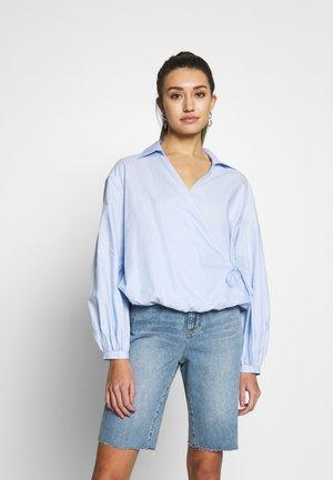 Blusa - light blue