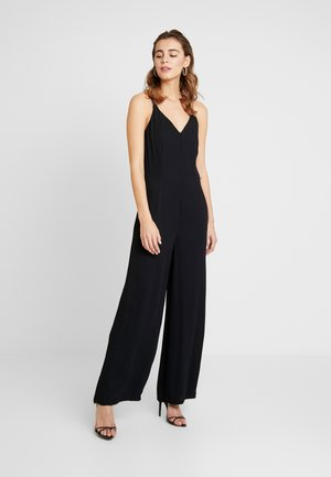 MANDULINE - Jumpsuit - black