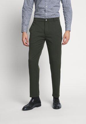 UGGE - Trousers - racing green