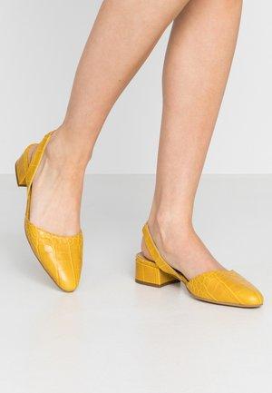 Klassieke pumps - jaune