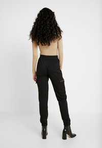 Missguided Tall - EMBROIDERED BRANDED - Tracksuit bottoms - black - 2
