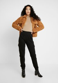 Missguided Tall - EMBROIDERED BRANDED - Tracksuit bottoms - black - 1