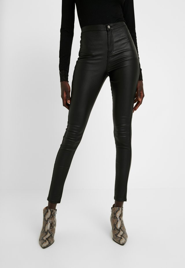 HIGH WAISTED COATED - Kangashousut - black