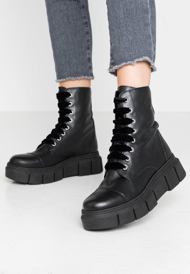 TAMESIS - Platform ankle boots - black