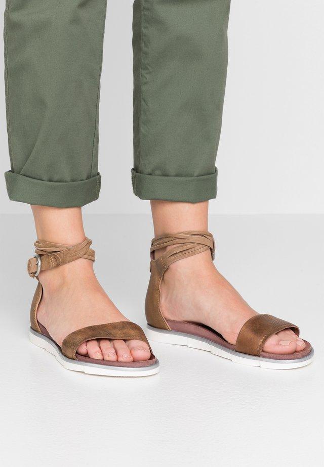 Sandaalit nilkkaremmillä - bronzo sand