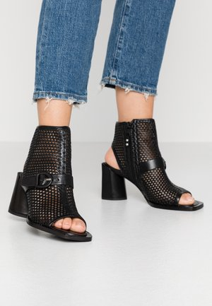 Ankle cuff sandals - nero