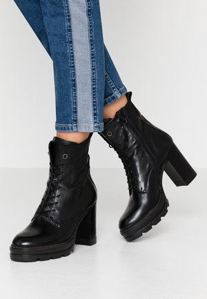 High heeled ankle boots - nero/terra