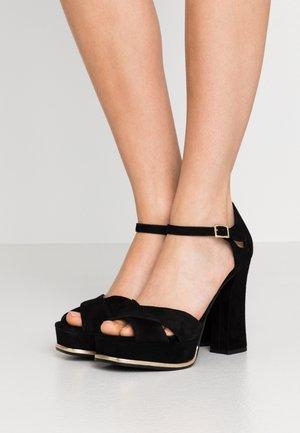 Korkeakorkoiset sandaalit - black/palegold