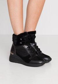 MICHAEL Michael Kors - Classic ankle boots - black - 0