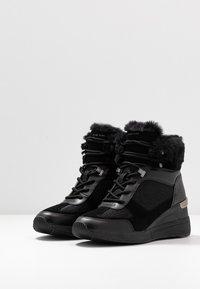 MICHAEL Michael Kors - Classic ankle boots - black - 4