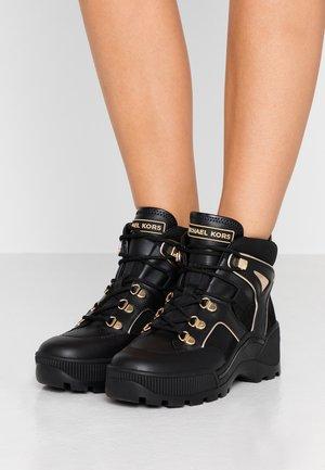 BROOKE - Ankle boots - black/palegold